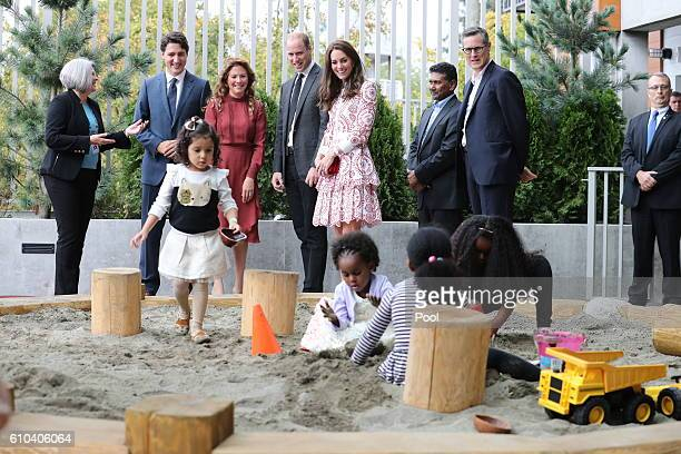 Catherine Duchess of Cambridge Prince William Duke of Cambridge Canadian Prime Minister Justin Trudeau and wife Sophie Trudeau watch children play in...