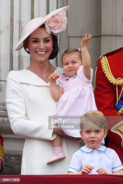 Catherine, Duchess of Cambridge, Princess Charlotte of Cambridge and Prince George of Cambridge watch a fly past during the Trooping the Colour, this...