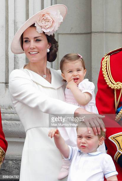 Catherine Duchess of Cambridge Princess Charlotte of Cambridge and Prince George of Cambridge watch the flypast from the balcony of Buckingham Palace...