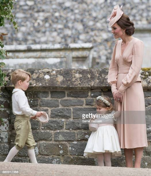 Catherine, Duchess of Cambridge, Princess Charlotte of Cambridge and Prince George of Cambridge attend the wedding Of Pippa Middleton and James...