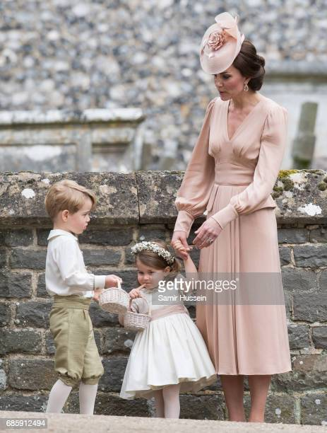Catherine Duchess of Cambridge Princess Charlotte of Cambridge and Prince George of Cambridge attend the wedding Of Pippa Middleton and James...