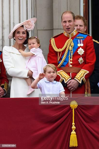 Catherine, Duchess of Cambridge, Princess Charlotte of Cambridge, Prince George of Cambridge and Prince William, Duke of Cambridge watch a fly past...