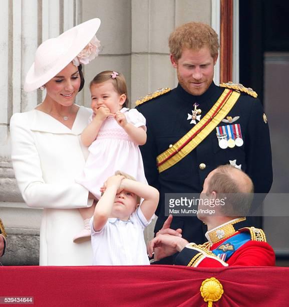 Catherine Duchess of Cambridge Princess Charlotte of Cambridge Prince George of Cambridge Prince Harry and Prince William Duke of Cambridge watch the...