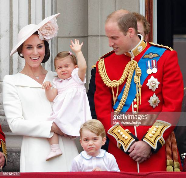 Catherine Duchess of Cambridge Princess Charlotte of Cambridge Prince George of Cambridge and Prince William Duke of Cambridge watch the flypast from...
