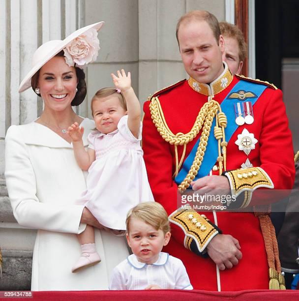 Catherine, Duchess of Cambridge, Princess Charlotte of Cambridge, Prince George of Cambridge and Prince William, Duke of Cambridge watch the flypast...