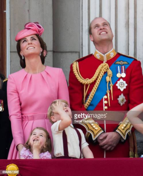 Catherine Duchess of Cambridge Princess Charlotte of Cambridge Prince George of Cambridge and Prince William Duke of Cambridge look on from the...
