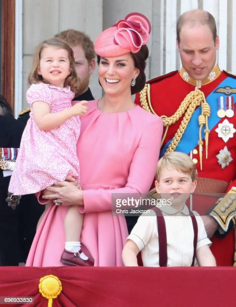 Catherine Duchess of Cambridge Princess Charlotte of Cambridge Prince George of Cambridge and Prince William Duke of Cambridge look out from the...