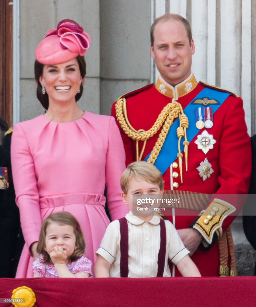 Catherine, Duchess of Cambridge, Princess Charlotte of Cambridge, Prince George of Cambridge and Prince William, Duke of Cambridge look on from the balcony during the annual Trooping The Colour parade on June 17, 2017 in London, England.