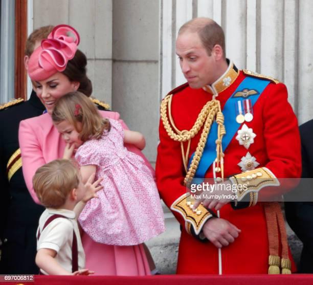 Catherine Duchess of Cambridge Princess Charlotte of Cambridge Prince George of Cambridge and Prince William Duke of Cambridge watch the flypast from...