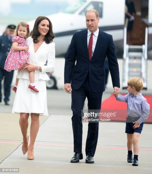 Catherine Duchess of Cambridge Princess Charlotte of Cambridge Prince William Duke of Cambridge and Prince George of Cambridge arrive at Warsaw...