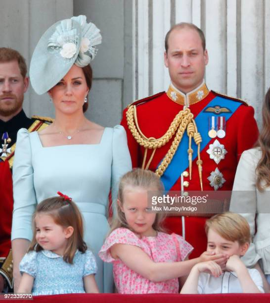 Catherine Duchess of Cambridge Princess Charlotte of Cambridge Prince William Duke of Cambridge and Savannah Phillips stand on the balcony of...