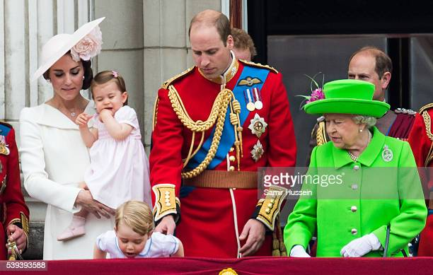 Catherine Duchess of Cambridge Princess Charlotte Prince George Prince William Duke of Cambridge Queen Elizabeth II stand on the balcony during the...