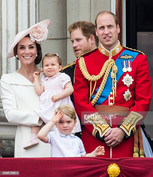 Catherine Duchess of Cambridge Princess Charlotte Prince George Prince William Duke of Cambridge stand on the balcony during the Trooping the Colour...