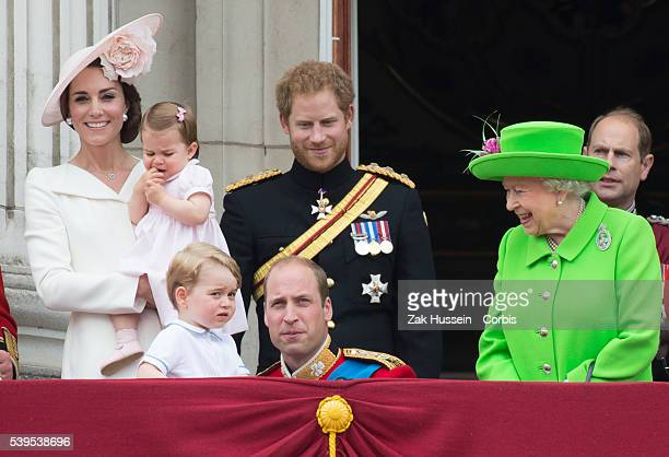 Catherine, Duchess of Cambridge, Princess Charlotte, Prince George, Prince William, Duke of Cambridge, Prince Harry and Queen Elizabeth II stand on...