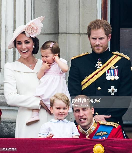 Catherine Duchess of Cambridge Princess Charlotte Prince George Prince Harry Prince William Duke of Cambridge stand on the balcony during the...