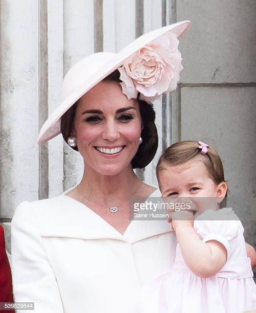Catherine, Duchess of Cambridge, Princess Charlotte stand on the balcony during the Trooping the Colour, this year marking the Queen's official 90th...