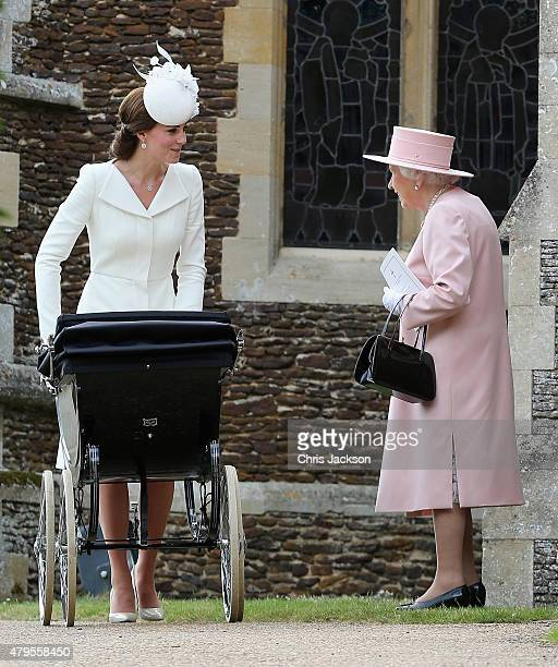 Catherine, Duchess of Cambridge pushes Princess Charlotte of Cambridge in her pram as Queen Elizabeth II looks on as they leave the Church of St Mary...