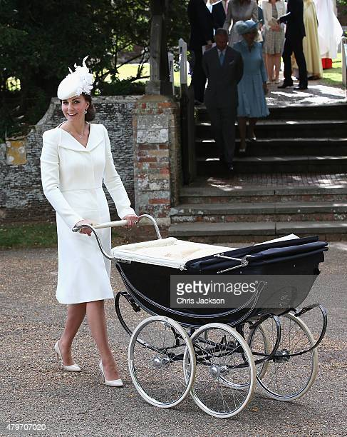 Catherine, Duchess of Cambridge pushes Princess Charlotte of Cambridge in her pram they leave the Church of St Mary Magdalene on the Sandringham...