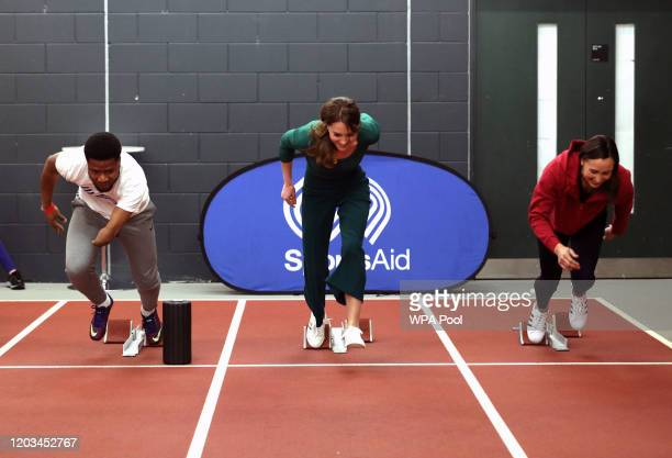 Catherine, Duchess of Cambridge races against para-athlete sprinter Emmanuel Oyinbo-Coker and heptathlete Jessica Ennis-Hill during a SportsAid Stars...