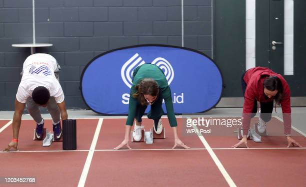 Catherine Duchess of Cambridge races against paraathlete sprinter Emmanuel OyinboCoker and heptathlete Jessica EnnisHill during a SportsAid Stars...