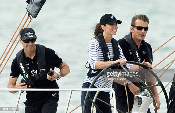 Catherine, Duchess of Cambridge races the New Zealand's Americas Cup Team yacht during their visit to Auckland Harbour on April 11, 2014 in Auckland,...
