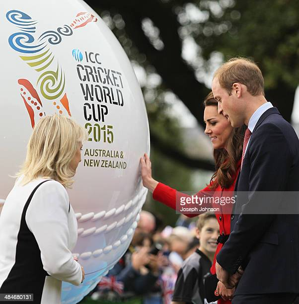 Catherine Duchess of Cambridge reaches out to touch the replica cricket ball with Prince William Duke of Cambridge Therese Walsh Head of New Zealand...