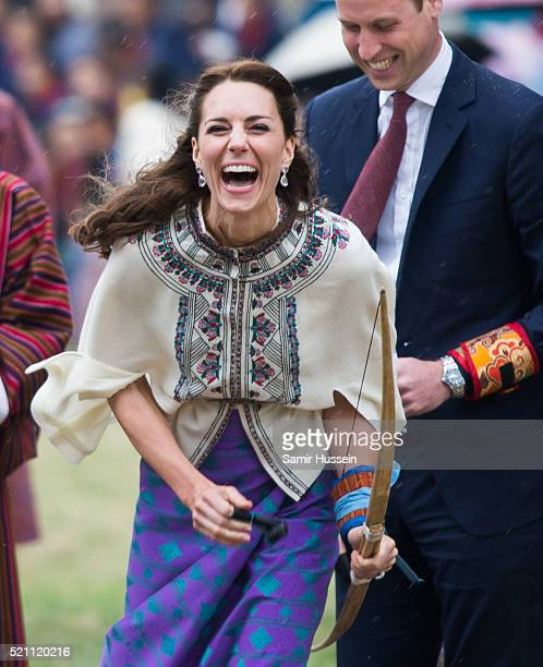 Catherine Duchess of Cambridge reacts as she takes part in archery at Thimphu's openair archery venue on April 14 2016 in Thimphu Bhutan