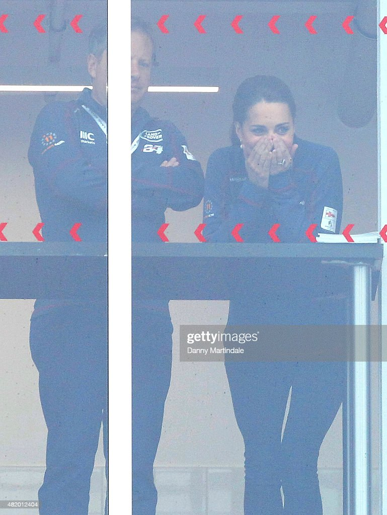 Catherine, Duchess of Cambridge reacts as she watches the Land Rover BAR team boat being lifted out of the water from a window during the America's Cup World Series which was cancelled due to the weather on July 26, 2015 in Portsmouth, England.