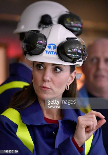 Catherine Duchess of Cambridge reacts at the control centre during a visit to Tata Steel on February 04 2020 in Port Talbot Wales