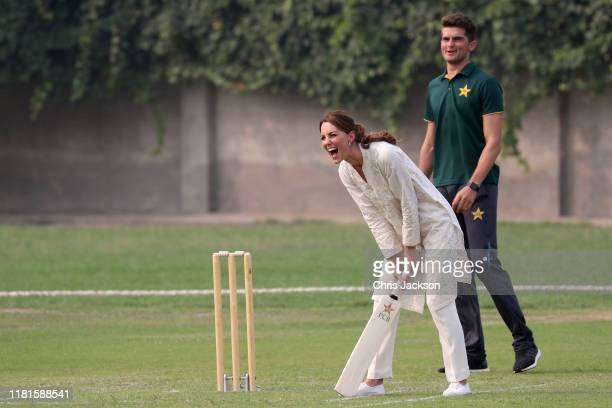 Catherine, Duchess of Cambridge reacts while playing cricket during her visit at the National Cricket Academy during day four of their royal tour of...