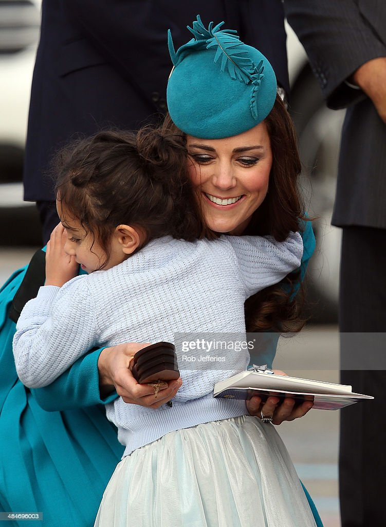 Catherine, Duchess of Cambridge receives a hug from a young fan at the official greeting at Dunedin International Airport on April 13, 2014 in Dunedin, New Zealand. The Duke and Duchess of Cambridge are on a three-week tour of Australia and New Zealand, the first official trip overseas with their son, Prince George of Cambridge.