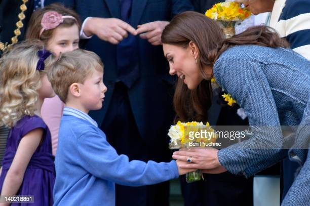 Catherine Duchess Of Cambridge receives a posy of daffodils while visiting Fortnum Mason store on St David's Day on March 1 2012 in London England...