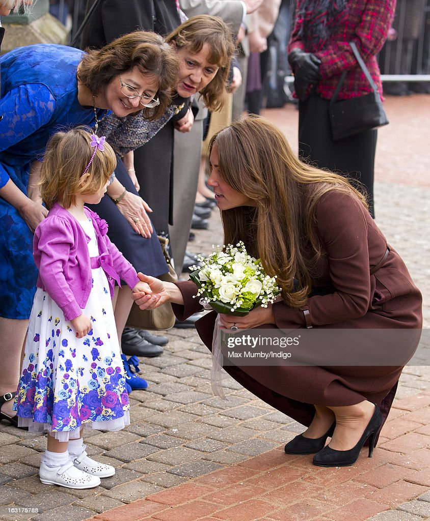 Catherine, Duchess of Cambridge receives a posy of flowers as she visits the National Fishing Heritage Centre whilst carrying out a day of engagements on March 5, 2013 in Grimsby, England.