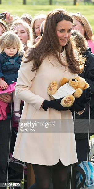 Catherine, Duchess of Cambridge receives a teddy bear as she visits the offices of Child Bereavement UK on March 19, 2013 in Saunderton,...