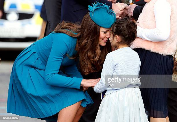 Catherine Duchess of Cambridge receives a traditional Maori welcome called a hongi from fiveyearold Mataawhio Matahaere Vieint at Dunedin...