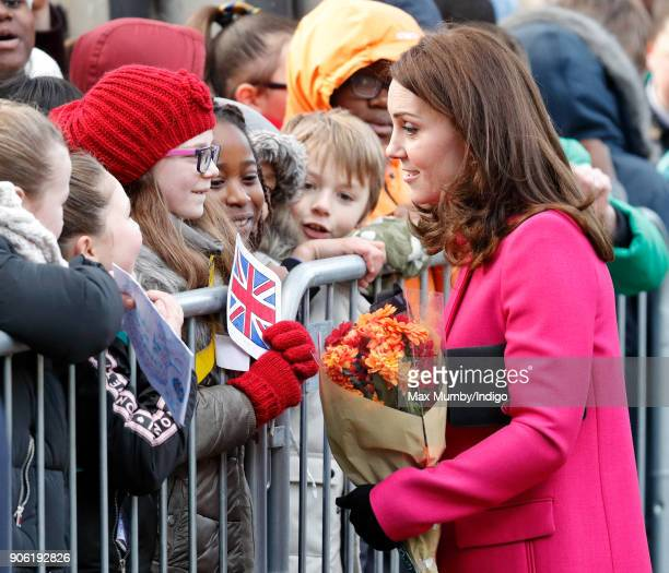 Catherine Duchess of Cambridge receives flowers from a young girl as she visits Coventry Cathedral on January 16 2018 in Coventry England