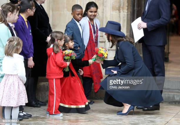 Catherine Duchess of Cambridge receives flowers from children as she departs from the 2018 Commonwealth Day service at Westminster Abbey on March 12...