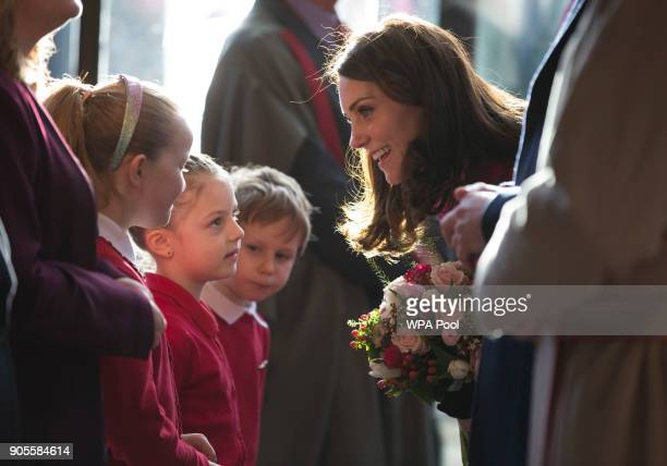 Catherine Duchess of Cambridge receives flowers from Megan Isabella and Szymek from Coundon Primary School at Coventry Cathedral during her visit to...