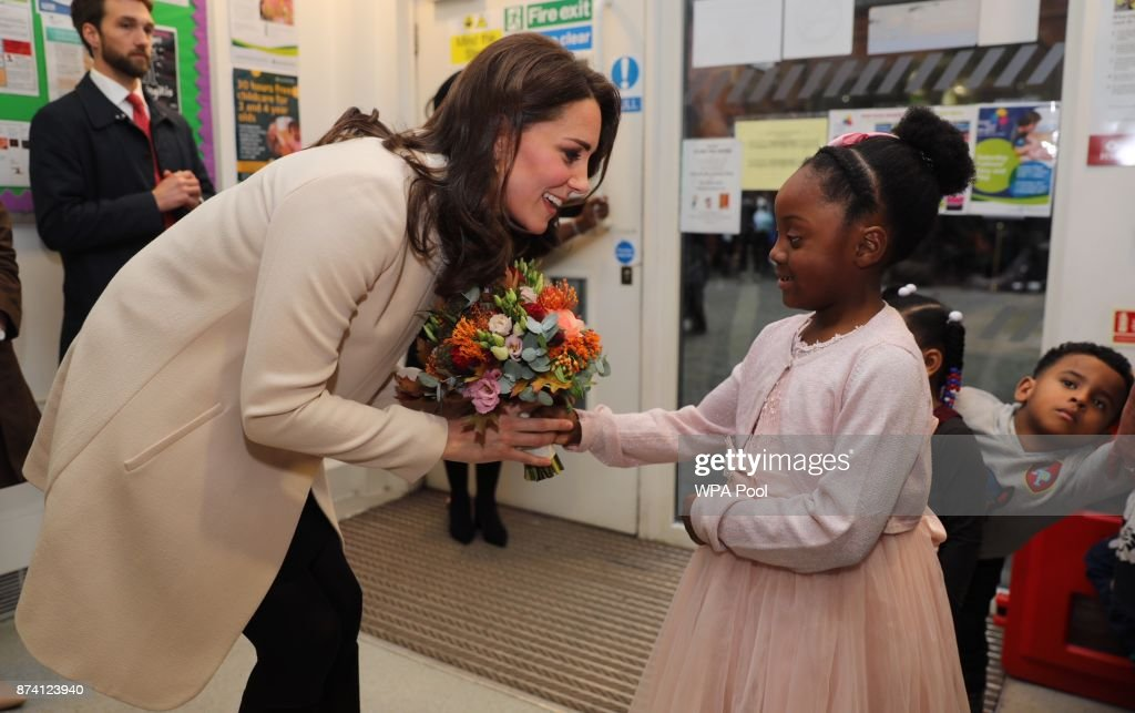 Catherine, Duchess of Cambridge receives flowers from six year old Nevaeh as she visits the Hornsey Road Children's Centre on November 14, 2017 in Hornsey, London, England.