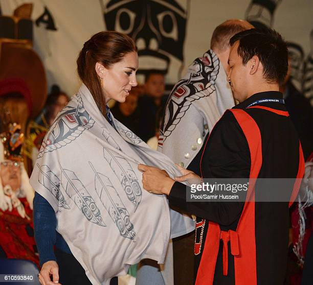 Catherine, Duchess of Cambridge receives gifts as she attends an official welcome and performance from Bella Bella First Nations Community at Wawiska...