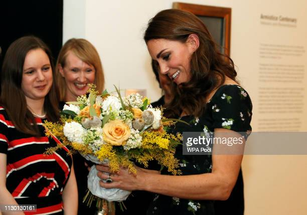Catherine Duchess of Cambridge receives some flowers as she attends the 2019 Portrait Gala at the National Portrait Gallery on March 12 2019 in...