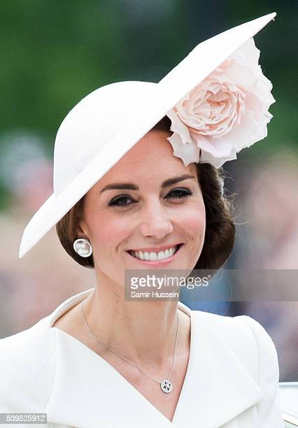 Catherine, Duchess of Cambridge ride by carriage during the Trooping the Colour, this year marking the Queen's official 90th birthday at The Mall on...
