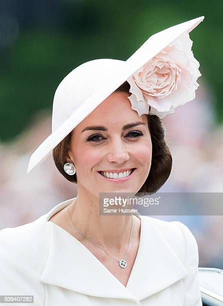 Catherine Duchess of Cambridge rides by carriage during the Trooping the Colour this year marking the Queen's official 90th birthday at The Mall on...