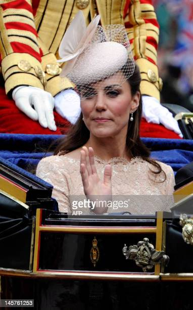 Catherine Duchess of Cambridge rides in a State Landau coach during the carriage procession from Westminster Hall to Buckingham Palace to celebrate...