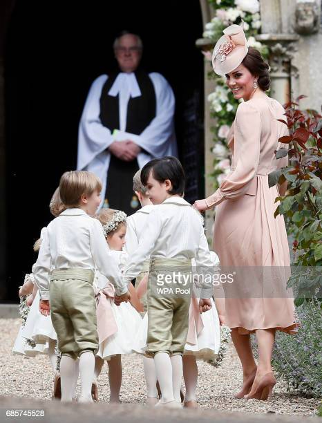 Catherine, Duchess of Cambridge, right, arrives with the pageboys and flower girls for the wedding of Pippa Middleton and James Matthews at St Mark's...