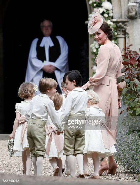 Catherine Duchess of Cambridge right arrives with the pageboys and flower girls for the wedding of Pippa Middleton and James Matthews at St Mark's...
