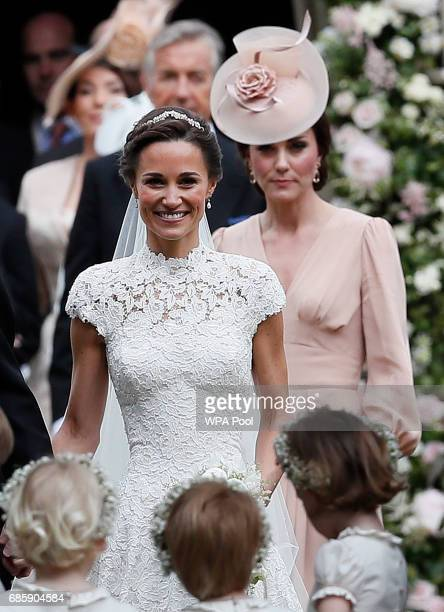 Catherine Duchess of Cambridge right follows the bride her sister Pippa Middleton after her wedding to James Matthews at St Mark's Church on May 20...