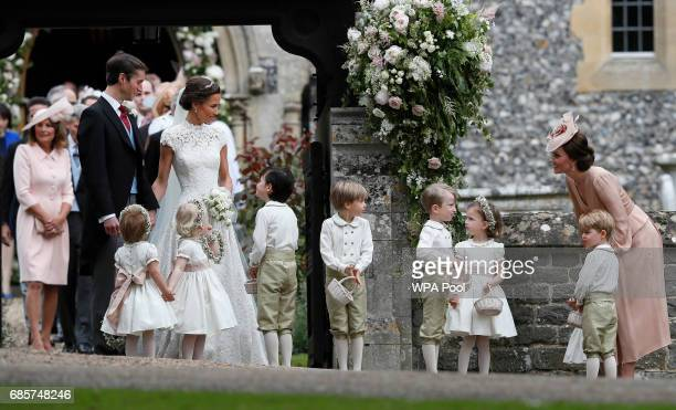Catherine Duchess of Cambridge right stands with her son Prince George as she looks across at Pippa Middleton and James Matthews after their wedding...
