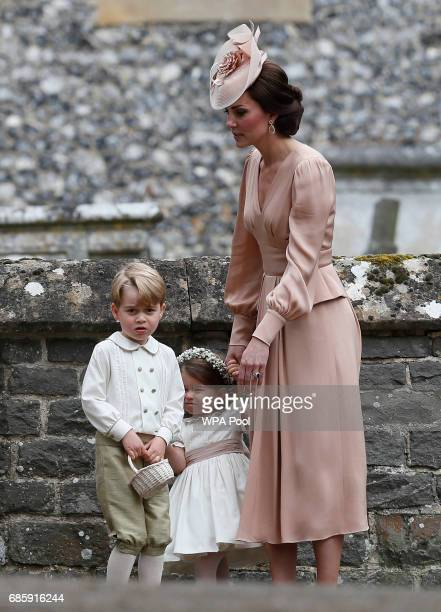 Catherine Duchess of Cambridge right stands with Princess Charlotte and Prince George who were flower boys and girls at the wedding of Pippa...
