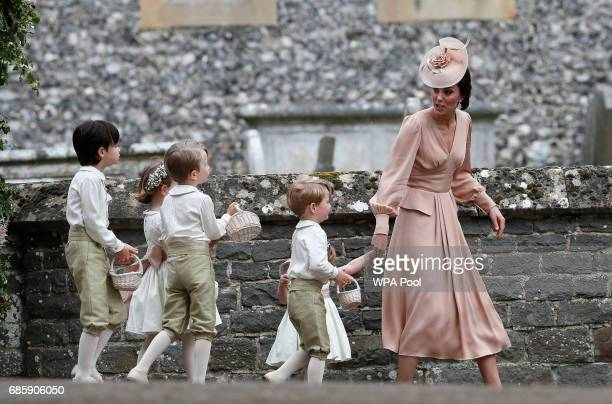 Catherine Duchess of Cambridge right walks with the flower boys and girls after the wedding of Pippa Middleton and James Matthews at St Mark's...